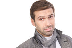 Young fashionable man wearing a scarf and gray clothes. Isolated over a white background Royalty Free Stock Photo