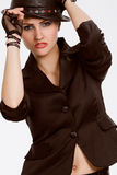 Young fashionable model with black hat Royalty Free Stock Images