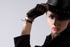 Young fashionable model with black hat Stock Image