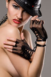 Young fashionable model with black hat Stock Photo