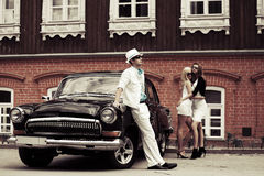Young fashionable people at the retro car Royalty Free Stock Photos
