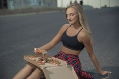 Young fashionable stylish model in summer hipster clothes. Cheerful, emotions. royalty free stock images