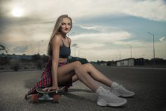 Young fashionable stylish model in summer hipster clothes. Cheerful, emotions. royalty free stock photos