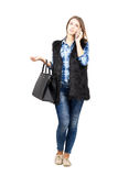 Young fashionable trendy woman talking on the smartphone Royalty Free Stock Photos