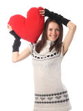 Young fashionable woman holding red heart Royalty Free Stock Photos