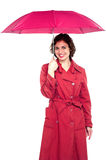 Young fashionable woman holding an umbrella Stock Photos