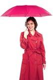 Young fashionable woman holding an umbrella Stock Photos