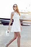 Young fashionable woman posing at boat Stock Photography