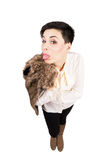 Young fashionable woman in winter clothes sticking out tongue Royalty Free Stock Image