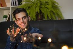 Young fashioned with christmas lights. At home royalty free stock image
