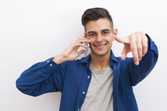 Portrait young fashion talking mobile phone. Young fashioned mobile phone on the wall Royalty Free Stock Image