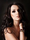 Young fasion woman with long hair and jewelry Stock Photography