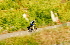 Young fast cyclist bicyclist active man riding a bike on a summe Stock Image