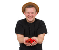 Young fat man with chili in his hands. Stock Image
