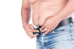 Young fat man  try wearing a belt Royalty Free Stock Photo