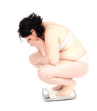 Young fat woman on scale Stock Photos