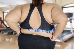 Young fat woman showing her belly fat Royalty Free Stock Photo