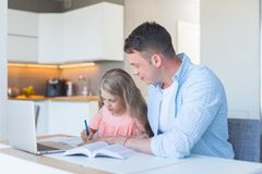 Young Father And A Little Daughter Doing Homework Stock Photos