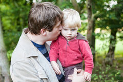 Young father and baby boy in spring forest Royalty Free Stock Photo