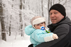 Young father and baby boy in winter snow forest Royalty Free Stock Photos