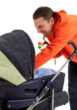 Young father with baby  buggy Royalty Free Stock Photo