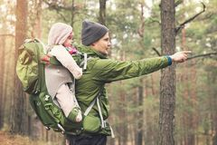 Father with baby in child carrier on a hike in the woods Stock Photos