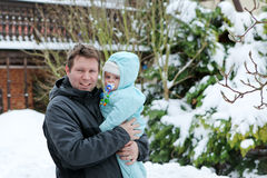 Young father and baby on cold winter day Stock Photos