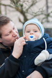 Young father and baby on cold winter day Stock Photo