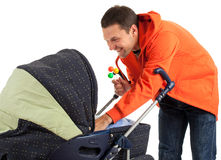Young father with baby pram Royalty Free Stock Image