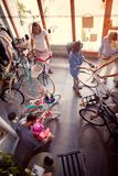 Young father buying new bicycle for little girl in bike shop top view. Young father buying new bicycle for happy little girl in bike shop top view royalty free stock photography