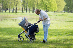 Young father with carriage Stock Photo