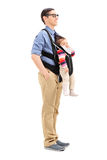 Young father carrying his baby daughter Royalty Free Stock Photography