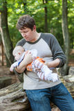 Young father carrying son in summer forest Royalty Free Stock Photo