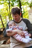 Young father carrying son in summer forest Royalty Free Stock Photos