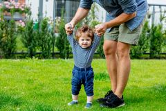 Young father with a child and first steps royalty free stock image