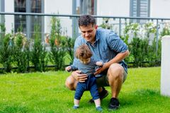 Young father with a child and first steps stock photography