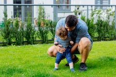 Young father with a child and first steps stock images