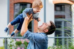 Young father with a child at outdoor stock images