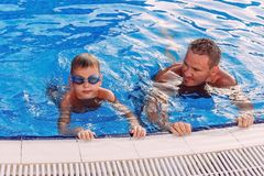 701702fecf Young father with child swim in outdoor pool on vacation royalty free stock  images