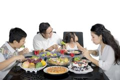 Young father convinces his daughter to eat Royalty Free Stock Photos