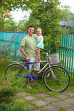 Young father and cute little daughter cycling Royalty Free Stock Photos
