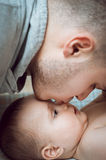 Young father dad tenderness kisses the daughter's nose Stock Photography