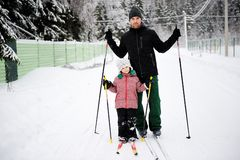 Young father and daughter do Nordic skiing Royalty Free Stock Photography