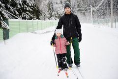 Young father and daughter do Nordic skiing Stock Photography