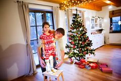 Young father with daughter having fun at Christmas time. Royalty Free Stock Image
