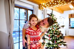 Young father with daughter having fun at Christmas time. Stock Photos