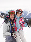 Young Father And Daughter On Ski Vacation Stock Image