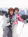 Young Father And Daughter On Ski Vacation Royalty Free Stock Images