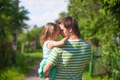 Young father with a daughter in the village Royalty Free Stock Photo