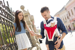 Young father with daughters. Young father with cute daughters on the street royalty free stock images